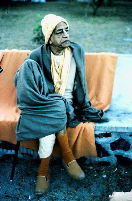 Prabhupada sitting on bench